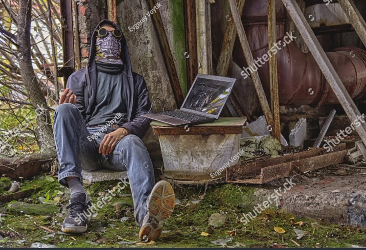 stock-photo-cyber-punk-or-fantastic-or-postapocalyptic-or-future-world-man-cosplayer-in-goggles-skull-mask-and-732282463