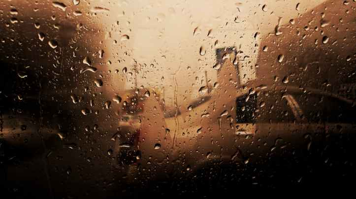 vehicle glass window with water droplets